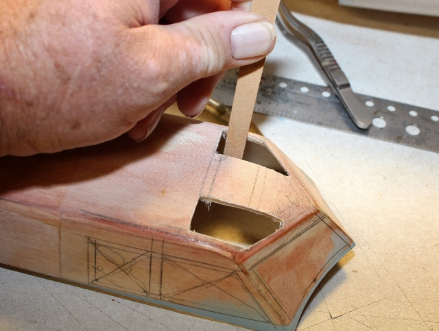B-17-15-42    An emery board is the best tool I have found for tight, precise sanding jobs like this.