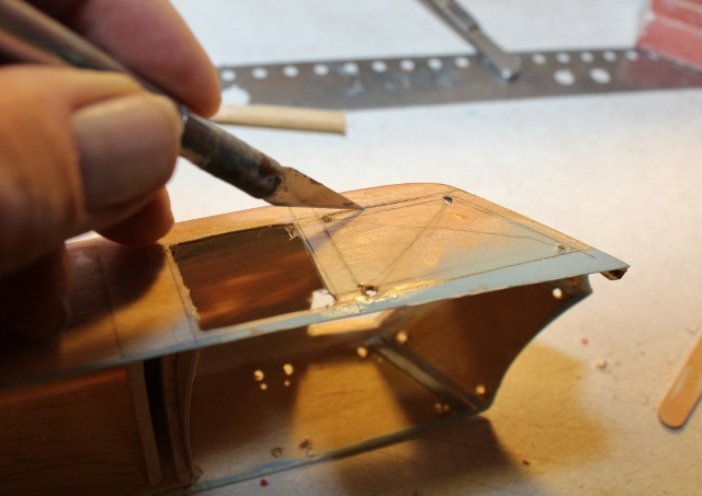 B-17-15-44     and VERY CAREFULLY cut out the window openings. While you weren't looking I did some more careful sanding of those window frames edges and…
