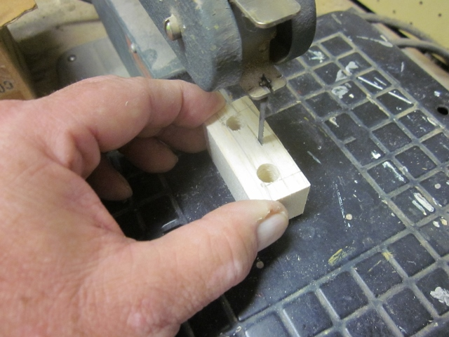 "PT-19-26   The next step is to use my Dremel scrollsaw to make the two linear cuts that join those 3/8""holes."