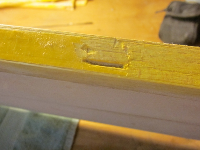 PT-19-34     When I removed the various control surfaces while stripping the old plastic covering, I elected to cut out all the old pinned, tab-type hinges. To get them out cleanly I had to take some extra balsa along with each one, and that left open slots like this one in the right wing aileron cutout, that need to be dealt with  before I can do anything about installing new hinges.