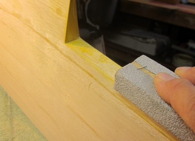PT-19-36   Now I can use an 80-grit sanding block  to cut each hinge slot insert  smooth and flush with the surrounding surface. With this done, I can later  mark and cut new hinge slots as if the old ones had never been there.
