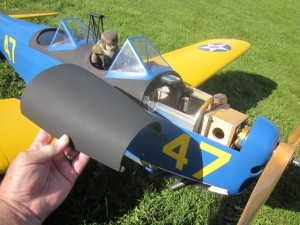 PT-19-126    That top cowl comes off for access to the battery pack, which happens to be a single 6S 5000 mAh Venom LiPo that slips under and past the top deck at the front windshield.