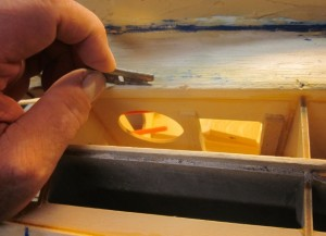 "PT-19-94   …right here as I use an ordinary razor blade to separate what's left of that old 1/8"" x ½"" balsa stringer from the edge of the servo plate. I'm creating a clear channel for the new 1/8"" x ½"" spruce stringer…"